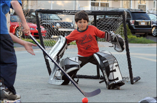 Bedford kids playing road hockey.