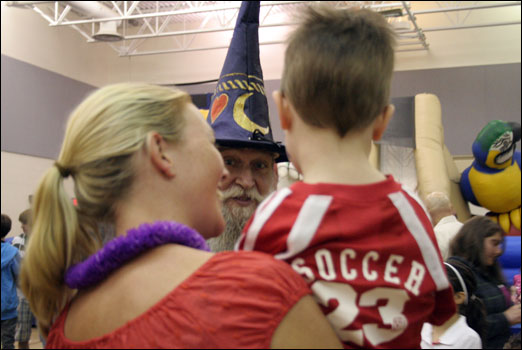 A wizard entertains a child at the Bedford South Spring Fair on Saturday. Photo: Susan Mills