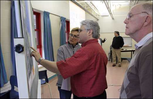 Bedford residents inspect one of three development concepts for the Bedford Waterfront. The concepts were unveiled during a public meeting at Basinview Drive Community School on Wednesday evening. Story to follow.