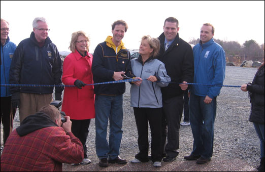 Bedford Councillor Tim Outhit, MLA for Bedford-Birch Cove Kelly Regan, Mayor Peter Kelly, Chamber of Commerce President Valerie Payn, MLA for Hammonds Plains-Upper Sackville Mat Whynott and President and CEO of the Waterfront Development Corporation Colin MacLean get ready to cut the ribbon.