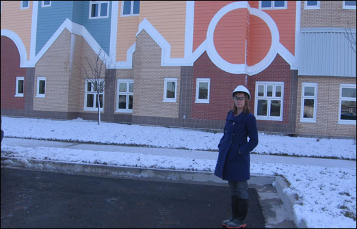 Holly MacLean, Public Relations Officer, stands in front of Northwood West Bedford Continuing Care Centre. The centre is scheduled to open in April 2010.