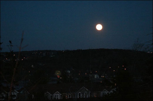 A full moon lights up Bedford, Nova Scotia on December 2, 2009.
