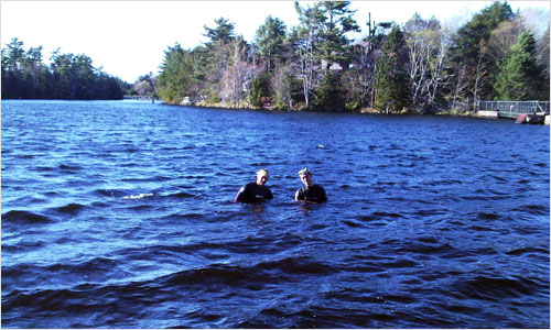 Two youths from the neighbourhood enjoy an evening dip in Papermill Lake on Friday evening.