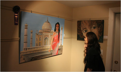 A spectator admires a painting of the Taj Majal during an opening reception at the Scott Manor House yesterday evening. This is the 4th annual Student Art Exhibition of its kind. The exhibit, which features artwork by students from primary to grade 12 in HRM, runs until July 4.