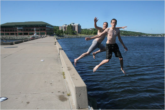 A couple of crazy Bedfordites jump off the jetty at the Bedford Waterfront on a hot and humid Friday afternoon. Photo by Ken Currie