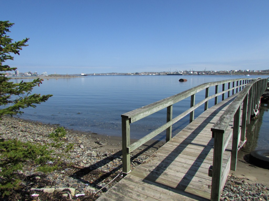 On the Dock at Timmins Cove on the East side of the island, notice that the refinery is  on the right and downtown Halifax on the Left