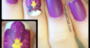 My attempt at an orchid! Wearing @essence_cosmetics Break Through to show off the @pantone Color Of The Year 2014! #pantone #coloriftheyear #radiantorchid #orchid #freehandnailart #flower #purple #2014