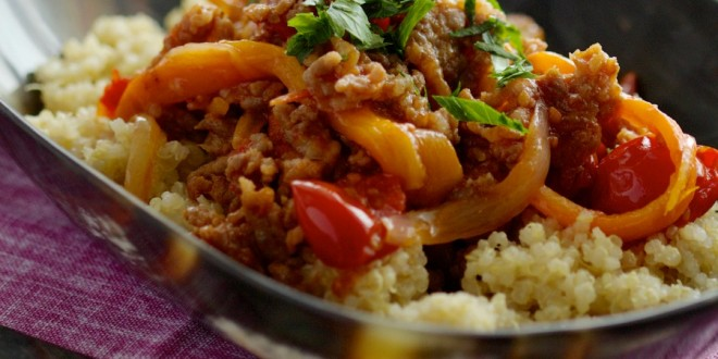 sausage with peppers & onions on quinoa polenta by The Culinary Chase