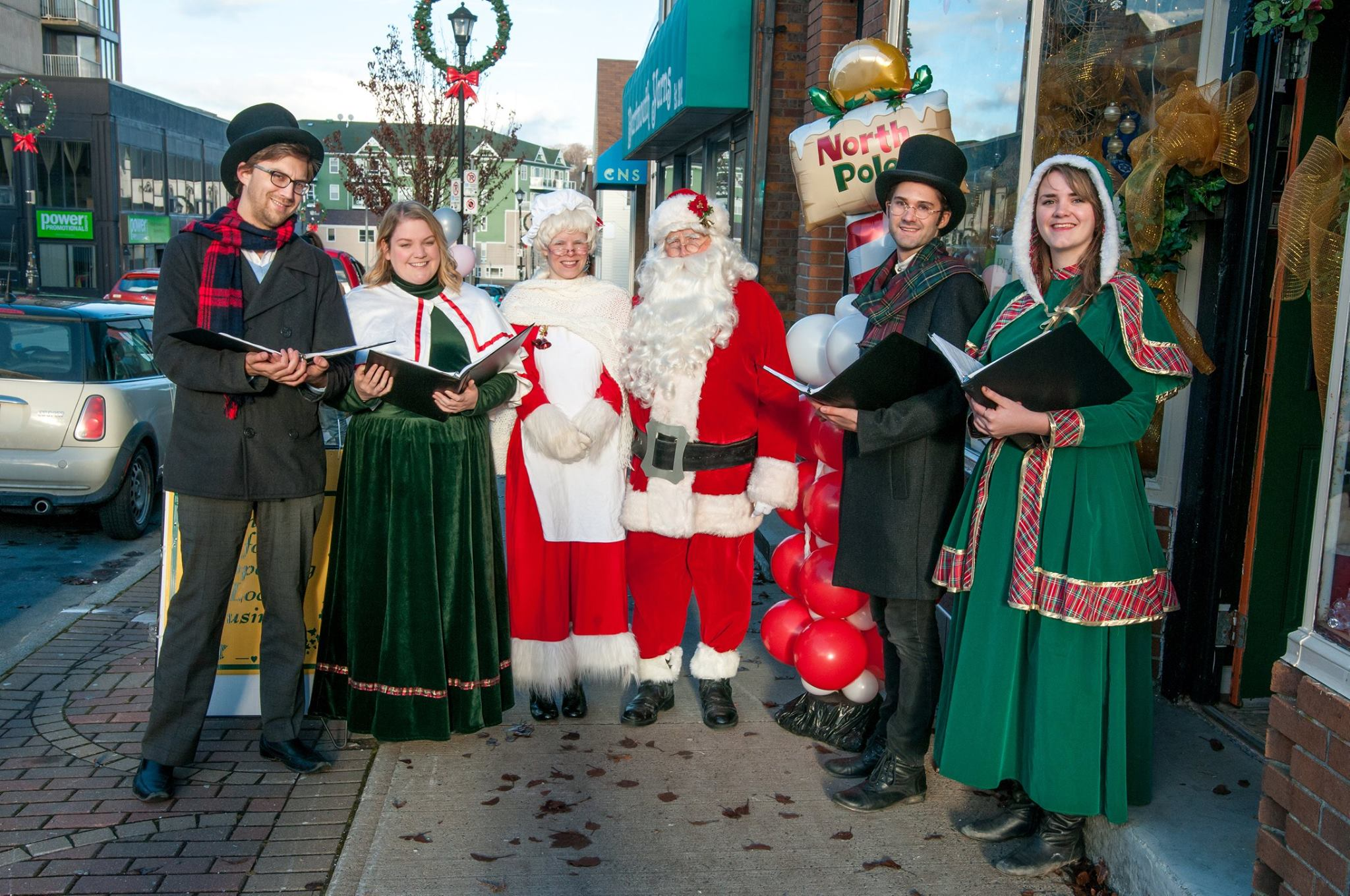 Michael Robson (2nd from the right)  making music with the East Coast Carollers in Downtown Dartmouth. (Photo credit: Jennifer Delorey Nextgen/DDBC)