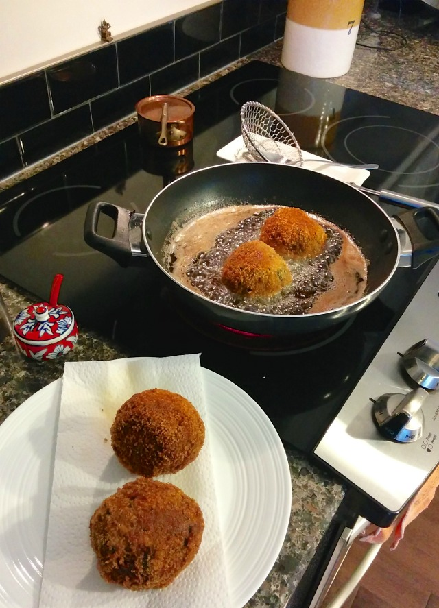 Scotch Eggs cooking in oil