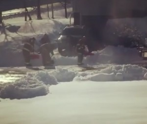Firefighters Shovelling