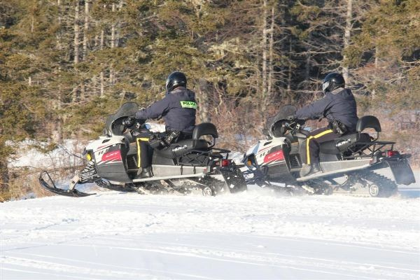 RCMP snowmobiling.